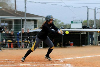 Image: Sophomore April Lusk doing her magic as a switch hitter for the Lady Gladiators. Lusk hit 2 triples along the way, recorded 5 RBIs and crossed home plate 11 times during the 2015 Tournament of Champions in Woodsboro.