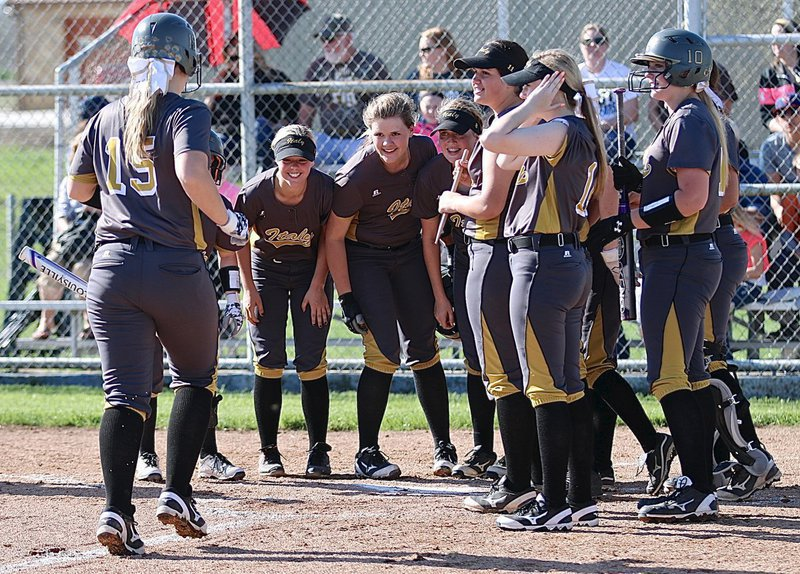 Image: Senior Jaclynn Lewis(15) is greeted at home plate by her Lady Gladiator teammates after hitting her first of two over-the-fence homeruns against Frost. Italy would go on to win their district opener 17-6.