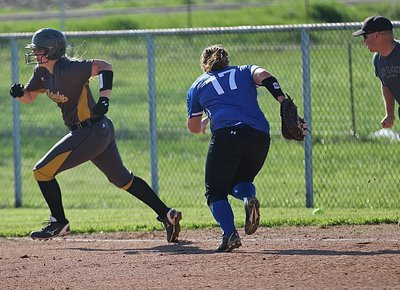 Image: Madison Washington(10) turns a single into  a three-bagger for the Lady Gladiators.
