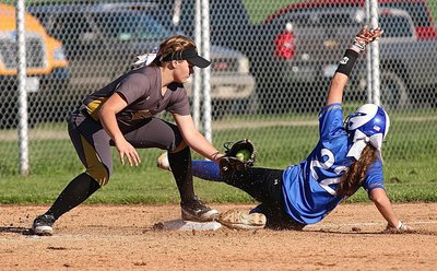 Image: A Frost runner just makes it before the tag by Lady Gladiator third-baseman Lillie Perry(9).