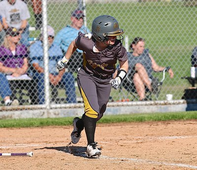 Image: Senior Tara Wallis(5) hits and then hurries to first-base for Italy.