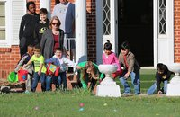 Image: And away they go! These excited Easter egg searchers take off across the front lawn of the S.M. Dunlap Memorial Library in Italy for the annual hunt.