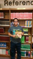 Image: Isaac Garcia holding the May/June issue of Texas Trophy Hunters Magazine where his article is published