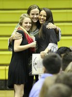 Image: Coach Holly Bradley hugs it out with Cross-Country teammates Britney Chambers and Ashlyn Jacinto.