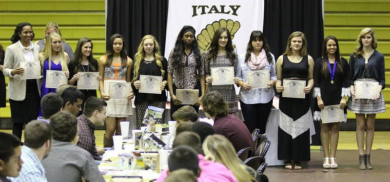 Image: The Varsity Volleyball Team was honored along with Head Coach Laquita Walker (far left) who was named the district's Coach-of-the-Year. Players receiving certificates were (L-R): Hannah Washington, Cassidy Childers, April Lusk, Brycelen Richards, Janae Robertson, Jozie Perkins, Jenna Holden, Lillie Perry, Ashlyn Jacinto and Halee Turner.