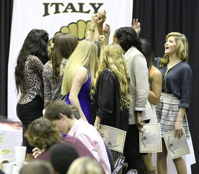 Image: The Lady Gladiator Volleyball Team shares one last huddle together to officially end the season.