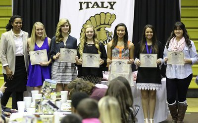 Image: Coach Laquita Walker presents All-District Awards to volleyball team members Hannah Washington, Halee Turner, Brycelen Jacinto, April Lusk, Ashlyn Jacinto and Jenna Holden.