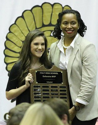 Image: Head Volleyball Coach Laquita Walker presents senior Cassidy Childers with the Italy Lady Gladiator Volleyball Defensive MVP Award.