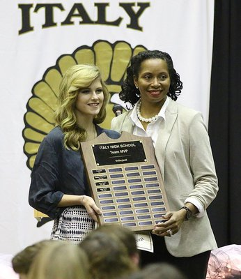 Image: Head Volleyball Coach Laquita Walker presents senior Halee Turner with the Team MVP Award.