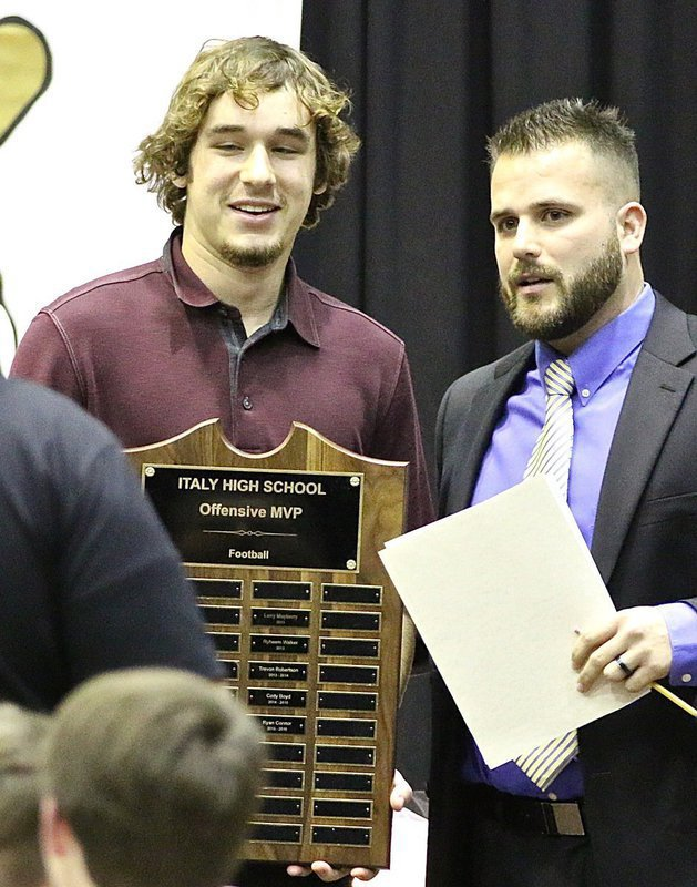 Image: Coach Daniel Weaver presents senior Ryan Connor with the Italy Gladiator Football Offensive MVP Award.