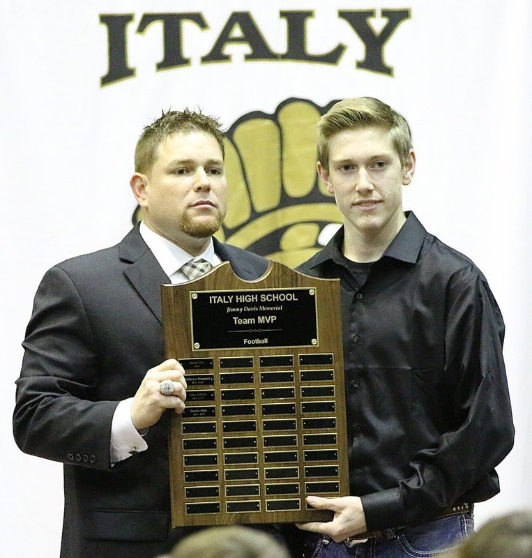 Image: Coach David Weaver present senior Clayton Miller with the Italy Gladiator Football, Jimmy Davis Memorial Team MVP Award.