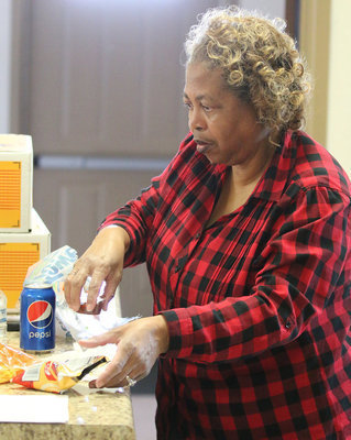 Image: Connie Singleton helps keep everybody well fed and having a good time.