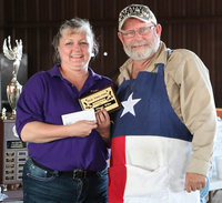 Image: Italy Lions Club member Flossie Gowin presents Terry Bowling, of Blooming Grove, with his 1st Place Ribs plaque and his $210.00 winner's check. Mr. Bowling was also the cook-off's Grand Champion, was awarded 3rd Place in the Chicken category, received 4th Place in the Brisket category, and received 6th Place in the Pork Butt category. He dedicated his accomplishments to his wife of 19 years, Glenda Ann Bowling (1953 – 2016), who passed away just two weeks before the cook-off.