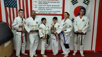 Image: Pictured in these two pictures are: Roger Sam, Nick Sam-Black Belt, Michael Bryant, Jacob Young-Black Belt, Jennifer Procopio and Antonio Procopio; also, one of the instructors Travis Tinney.