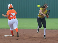 Image: Lady Gladiator shortstop April Lusk attempts to pull off a double-play.