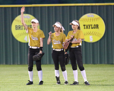 Image: Italy outfielders Taylor Boyd, senior Britney Chambers and Karley Nelson have the infield's back against Avalon.