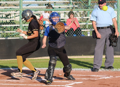 Image: April Lusk(7) outruns the throw to home to score a another run for Italy.