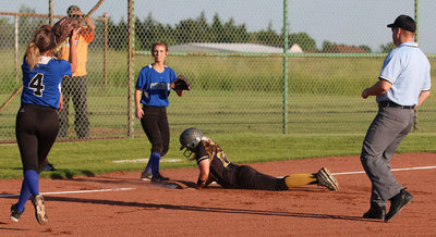 Image: Lady Gladiator Brycelen Richards(17) slides safely into third-base.