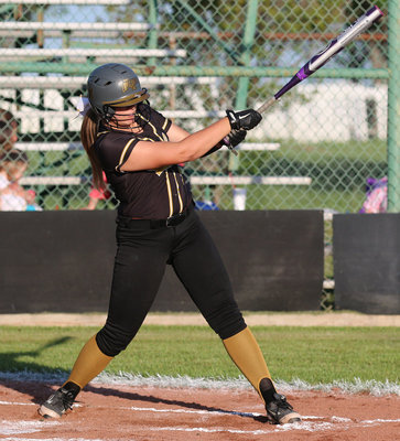 Image: Senior slugger Lillie Perry(9) blasts a double at covington.