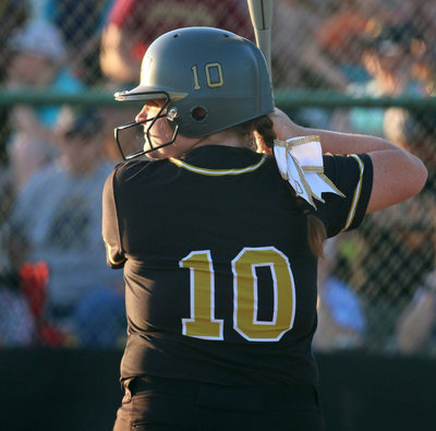 Image: DH Raegan Jones(10) looks for just the right pitch against Covington.