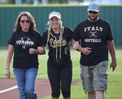Image: Italy Lady Gladiator senior Hannah Washington is escorted by her family before the game while being honored during Senior Day at Johnny Jones Field.