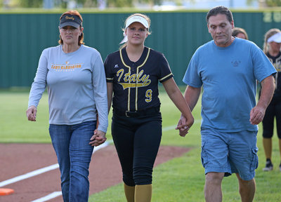 Image: Italy Lady Gladiator senior Lillie Perry is escorted by her parents before the game while being honored during Senior Day as mother, Deborah Perry tries hold back those tears.