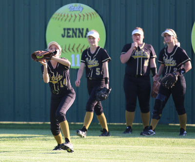 Image: Lady Gladiator Karley Nelson(14) shags a fly ball before the game against Covington.