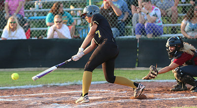 Image: Lady Gladiator April Lusk(7) digs one out to reach first-base safely.
