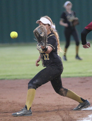 Image: Brycelen Richards(17) does what she does at first-base against Riesel.