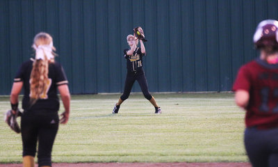 Image: Italy Lady Gladiator Freshman Karley Nelson(14) makes a senior level play by catching a Riesel pop-up to end the game and give Italy a 1-0 lead in the series.