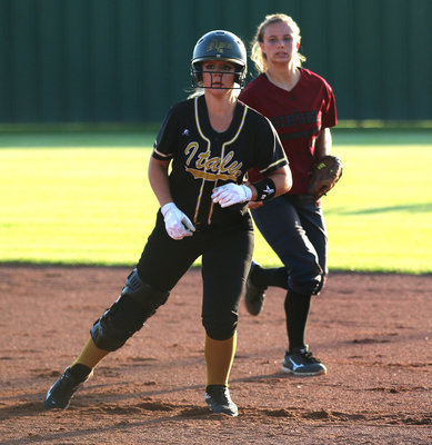 Image: Junior Lady Gladiator Brooke DeBorde(2) looks for a chance to reach second-base against Riesel.