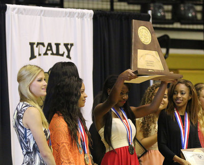 Image: Freshman Chardonae Talton does the honors on behalf of her state champion track teammates as she hoists the 2016 Conference AA UIL State Championship trophy high for Italy fans upon which to gaze during the Italy Athletic Department's spring banquet.