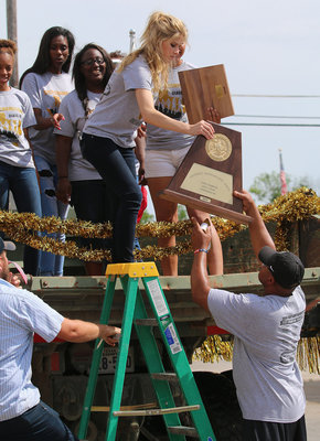 Image: You know you are on top of the world when you need a ladder to get down. Senior Lady Gladiator Halee Turner and her teammates make their way down from the dump truck they paraded in on.