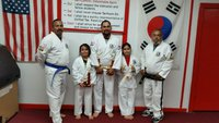 Image: Pictured are Roger Sam, Turtle Cadet Instructor,  a program for 3, 4 and 5 year old children, Analy Salas, Juan Salas, Joana Salas, and Master Charles Kight-Chief Instructor of the Hillsboro Unified Tae Kwon Do School.