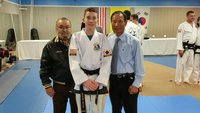 Image: Pictured are Master Charles Kight, Michael and Grand Master BuKwon Park.