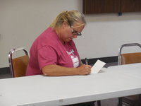 Image: Kim Varner writes a note of encouragement for a student.