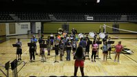 Image: Band students stood while playing their first two songs.