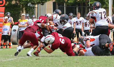 Image: Sophomore Season: During the 2015 season against Hendrix, Austin College sophomore nose guard #68 Zain Byers comes up big on a 4th down stop for the Kangaroos along with teammate #22 Kendall St. Romain, a junior out of Arlington, Texas / Mansfield Timberview.