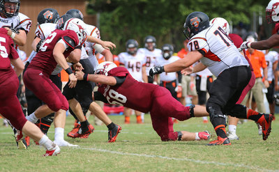 Image: Sophomore Season: Austin College Kangaroo #68 Zain Byers records a tackle against Hendrix during his sophomore season at Austin College.