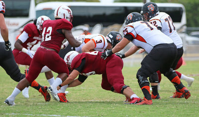 Image: Sophomore Season: Austin College sophomore nose guard #68 Zain Byers making his first official collegiate tackle on play three of the 2015 season opener against Hendrix.