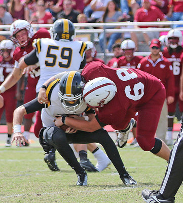 Image: Sophomore Season: A sophomore back in 2015, Austin College nose guard #68 Zain Byers recorded his first collegiate sack against the Southwestern Pirates.