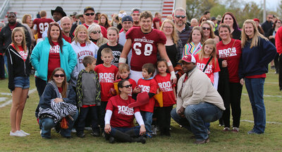 Image: Sophomore Season: #68 Zain's Byers with his family members, friends and former Italy High School football teammates, Shad Newman and Kevin Roldan (Back center), during Austin College Homecoming 2015. Also pictured in the light blue sweater is Zain's cousin, Lauren Byers, also an Italy graduate.
