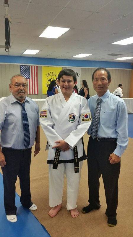 Image: Rocklin Ginnett with Master Charles Kight, Luis and Grand Master BuKwon Park, co founder of Unified Tae Kwon Do.