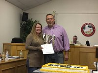 Image: Mayor Farmer presents Amber Cunningham with the proclamation naming her as IYAA Volunteer of the year.