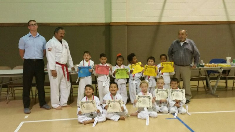 Image: Pictured: Top Row: Travis Tinney, Instructor,  Roger Sam, Turtle Cadet Instructor, Gryphon Kight-Waco, Daniel Goates-West, Jocelyne Crisostomo-Hillsboro, Ryan Thompson-Penelope, David Flores-Hillsboro, Ayden Vargas-Hillsboro and Master Charles Kight-Chief Instructor of the school.     Front Row:  Elile Morales-Itasca, Fabian Morales-Itasca, Harmony McKnight-Whitney, Christian McKnight-Whitney and Noah Hayes-Italy.