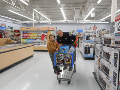 Image: Chief Beckham helps one of the students shop for his family.