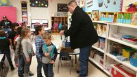 Image: Michael Buss, Carter's consultant for Italy ISD, passes out medals to Mrs. Nelson's class.