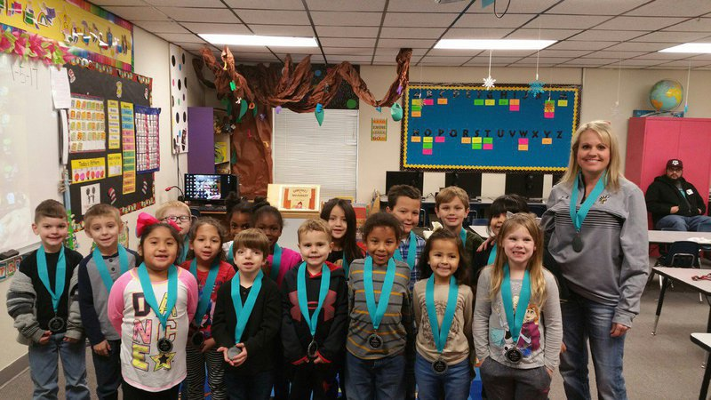 Image: Mrs. Nelson's kindergarten class shows off their medals for winning Carter Blood Care's contest at Stafford  Elementary—their class had the most donations given in their name.