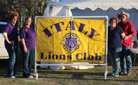 Image: Italy Lions Club members Meg Lyons, and Flossie Gowin, along with fellow members Karen and Donald Brummett pose with the Italy Lion Club banner after as the 2017 BBQ Cook-off comes to a successful end.