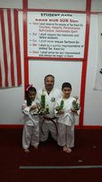 Image: Jocelyne Crisostomo from Hillsboro, Instructor Roger Sam of Italy and Daniel Goates of West brought home the trophies to show the hard work and dedication these two 5 years olds and Mr. Sam have accomplished.